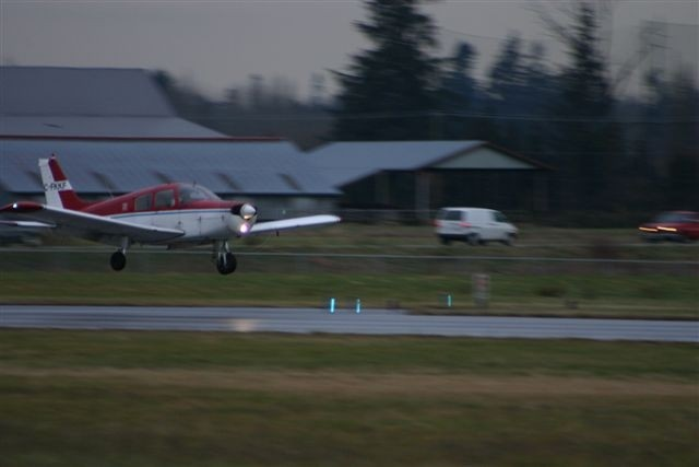 Piper Cherokee FKKF duirng landing flare onto Runway 01 at Langley Airport.  Langley Flying School.