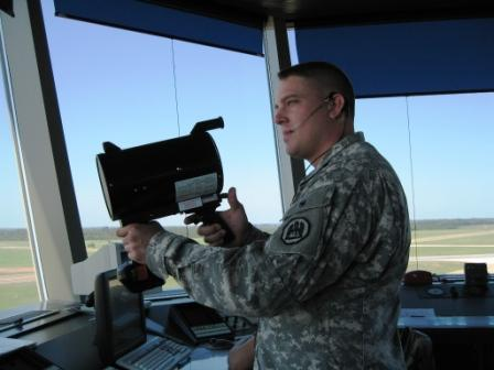 Military air traffic controller with light gun.  Courtesy Wikipedia.  Langley Flying School.